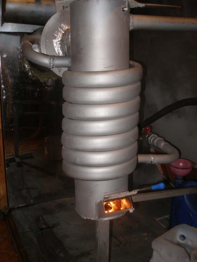 Печка занимает много мета, лучше выбрать место для её установки заранее. Поэтому и нужно думать о том, как обогреть гараж зимой, заранее.